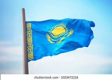 Flag of Kazakhstan against the background of the sky
