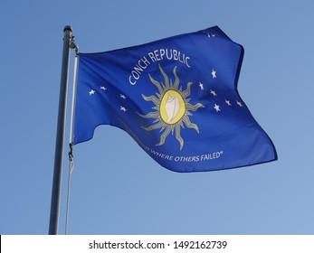 Flag of Key West, Florida, flying out in the wind from a pole