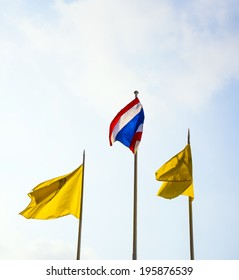 flag of the king of Thailand and the thai national flag in front of the Grand Palace in Bangkok