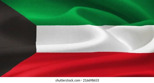 Flag of Kuwait waving in the wind. Silk texture pattern