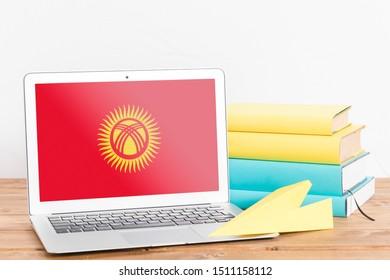 Flag of Kyrgyzstan on Laptop. Kyrgyzstan Flag on Screen.