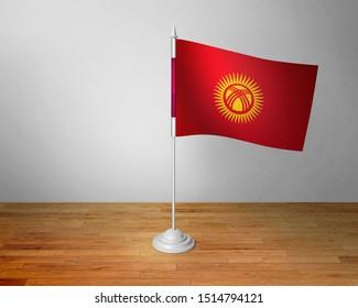 Flag of Kyrgyzstan Table. Kyrgyzstan Desk Flag on Wooden Table.
