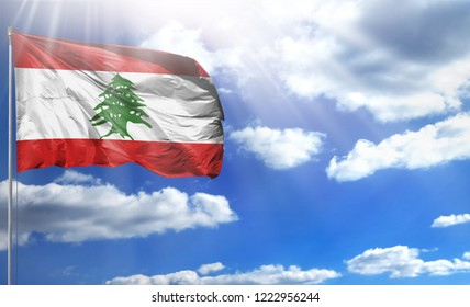 Flag of Lebanon on a flagpole against a blue sky, with a good place for your text.
