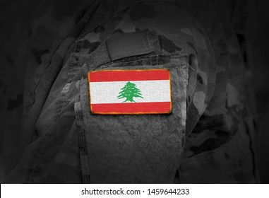 Flag of Lebanon on soldiers arm (collage).