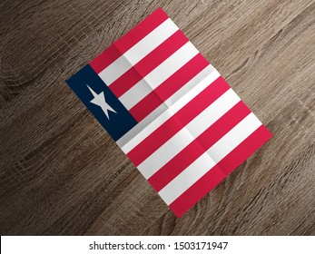 Flag of Liberia on paper. Liberia Flag on wooden table.