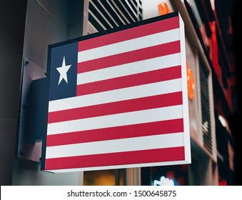 Flag of Liberia on Shop Sign. Flag of Liberia on Advertisement Board