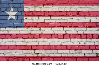 Flag of Liberia painted on brick wall, background texture