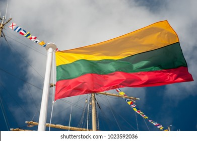 Flag of Lithuania over blue sky background. Lithuanian Communities around the globe are celebrating the 100th Anniversary of the Restoration of the Independent State of Lithuania on 16 February, 2018.