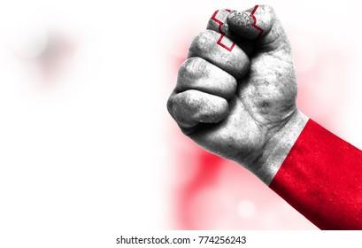 Flag of malta painted on male fist