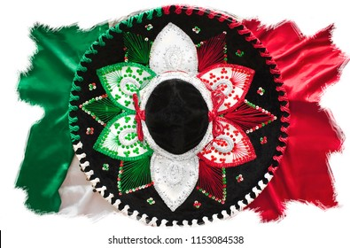 Flag of Mexico. Mexican sombrero. Top view photo. México Independence Day. Background template for headers, newsletters, congratulations for subscribers. Rough scratchy ragged edges. White background