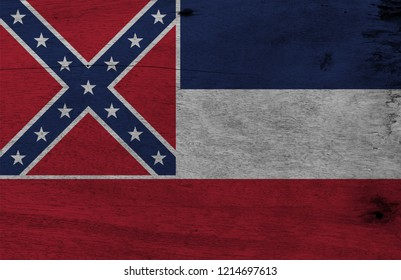 Flag of Mississippi on wooden plate background. Grunge Mississippi flag texture, The states of America. The canton is square, spans two stripes, consists of a red with a blue saltire with star.