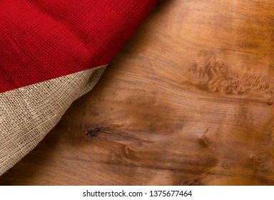 Flag of Monaco from rough fabric on a wooden surface