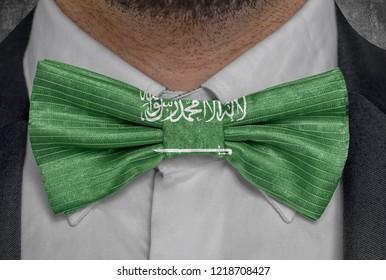 Flag national of Saudi Arabia on bowtie business man suit
