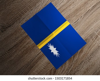 Flag of Nauru on paper. Nauru Flag on wooden table.