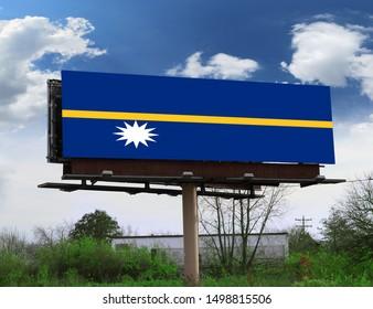 Flag of Nauru on wooden board. Paper Flag of Nauru on wooden table.