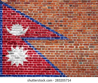 Flag of Nepal painted on brick wall, background texture