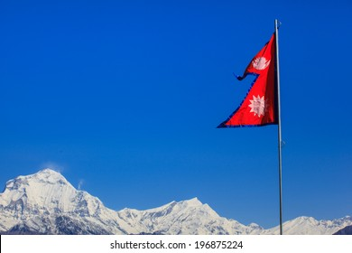 Flag of Nepal waving with himalayan view, Poon Hill, Nepal