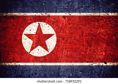 flag of North Korea or North Korean banner on scratched rough texture