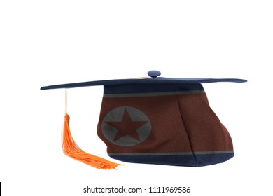 Flag of North Korea on Graduation Cap isolated on a white background