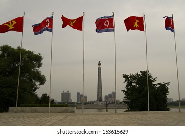 Flag of North Korea and flag of the Workers' Party of Korea. The center of Pyongyang - the capital of North Korea.