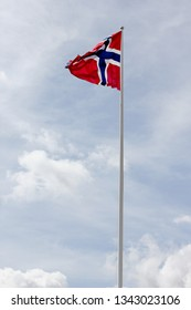 The flag of Norway against a cloudy sky