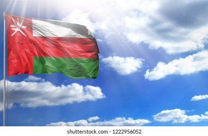 Flag of Oman on a flagpole against a blue sky, with a good place for your text.