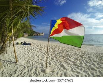 Flag on the beach Anse Pierrot, La Digue, Seychelles