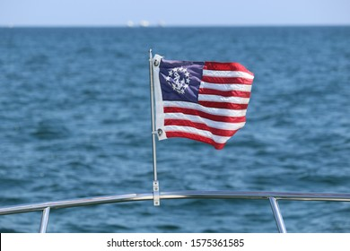flag on front of a boat in the ocean