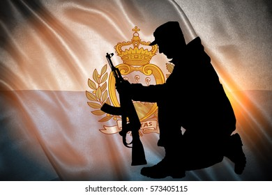 Flag with original proportions. Closeup of grunge flag of San Marino with the silhouette of a soldier with a gun