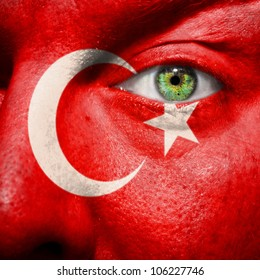 Flag painted on face with green eye to show Turkey support