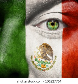 Flag painted on face with green eye to show mexico support
