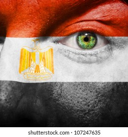 Flag painted on face with green eye to show Egypt support