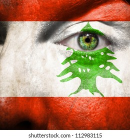 Flag painted on face with green eye to show Lebanon support