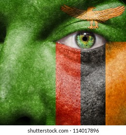 Flag painted on face with green eye to show Zambia support