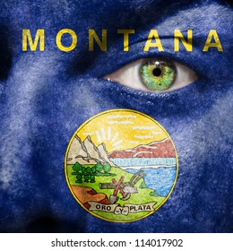 Flag painted on face with green eye to show Montana support