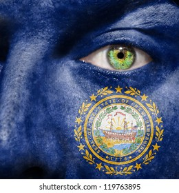 Flag painted on face with green eye to show New Hampshire support