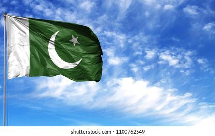 Flag of Pakistan on flagpole against the blue sky