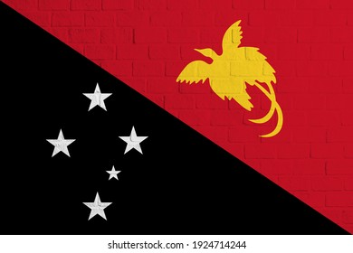 Flag of Papua New Guinea. Brick wall texture of the flag of Papua New Guinea.