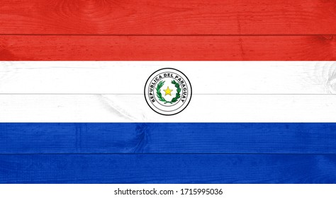 flag of Paraguay or Paraguayan banner on wooden background
