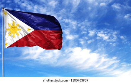 Flag of Philippines on flagpole against the blue sky