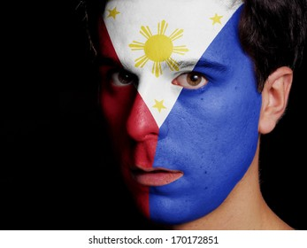 Flag of Philippines Painted on a Face of a Young Man