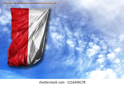 Flag of Poland. Vertical flag, against blue sky with place for your text