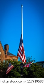 A flag pole with its US flag at half staff in Gettysburg, PA.