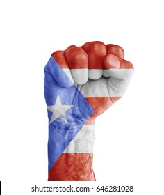 Flag of Puerto Rico painted on human fist like victory symbol