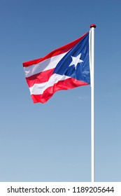 Flag of Puerto Rico waving in the sky