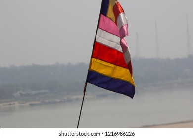 Flag of Religion. Buddhist Flag. The Buddhist flag behind is the river view. Buddhist flag in many colors.