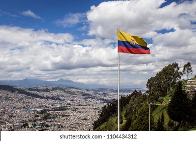 Flag of the Republic of Ecuador, on a sunny day with the city of Quito in the background. Concept of patriotism and pride
