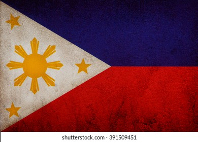 Flag of Republic of the Philippines on old wall texture background.