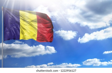 Flag of Romania on a flagpole against a blue sky, with a good place for your text.