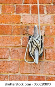 Flag rope cleat on red brick wall/Flag Cleat with Rope/Knots